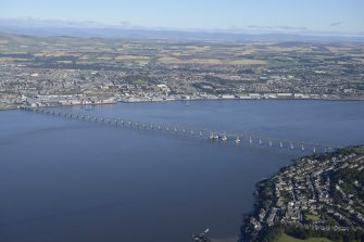General oblique aerial view of the River Tay centred on the Tay Bridge with Dundee beyond, taken from the SW.