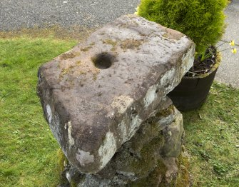 "View of ""cup stone"" situated outside door to Daviot church"