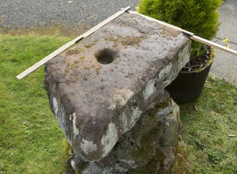 "View of  ""cup stone"" (with scale) situated outside door to Daviot church"