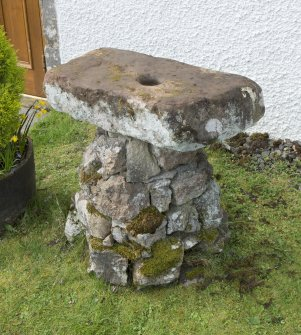 "View of ""cup stone"" and base situated outside door to Daviot church"