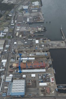 General oblique aerial view of Rosyth Dockyard centred on the Goliath Crane, looking to the ESE.