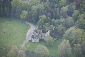 Oblique aerial view of Brucklay Castle, looking to the E.