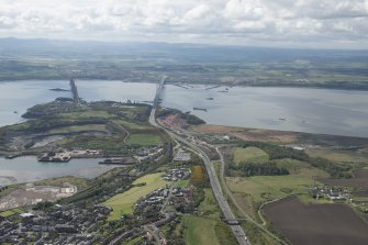 General oblique aerial view of the River Forth centred on the new  Forth Bridge crossing, looking to the S.