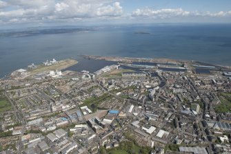 General oblique aerial view of Leith Docks centred on the Caledonia Flour Mills, looking to the ENE.