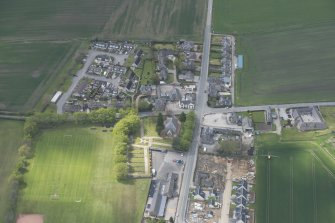 General oblique aerial view of Echt centred on Echt Parish Church, looking to the W.
