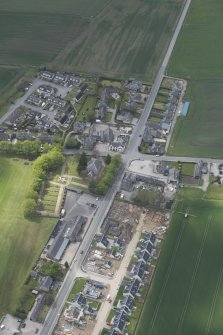 General oblique aerial view of Echt centred on Echt Parish Church, looking to the WSW.