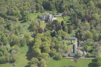 General oblique aerial view of Kemnay House with adjacent farm house, looking to the SSE.