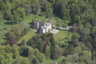 Oblique aerial view of Kemnay House, looking to the E.