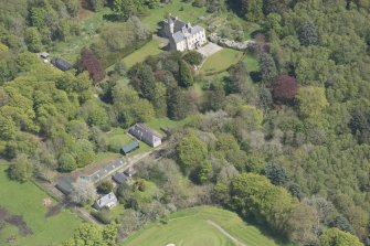 General oblique aerial view of Kemnay House with adjacent farm house, looking to the E.