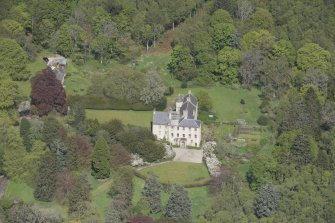 Oblique aerial view of Kemnay House, looking to the NNE.