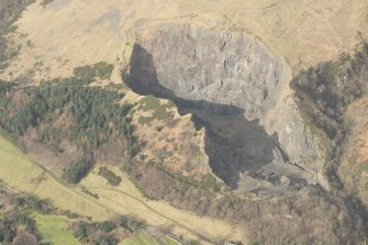 Oblique aerial view of Castle Craig quarry, looking NNW.
