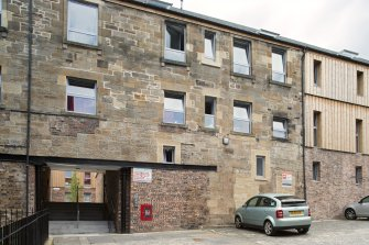 View  of converted brewery buildings in Sugarhouse Close, 160 Canongate, Edinburgh, from E.