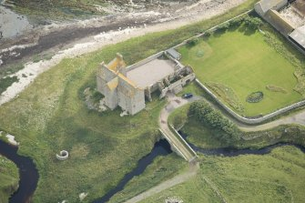 Oblique aerial view of Freswick Castle and bridge, looking ESE.