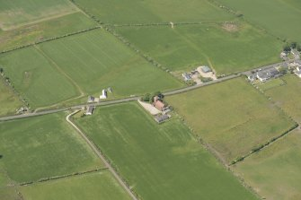 Oblique aerial view of St Molio's Church, looking to the NW.