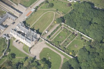 Oblique aerial view of Sandside House and walled garden, looking to the NNE.