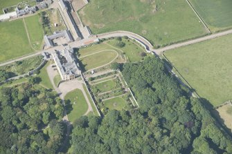 Oblique aerial view of Sandside House and walled garden, looking to the N.
