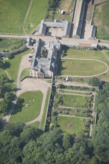 Oblique aerial view of Sandside House and walled garden, looking to the NW.