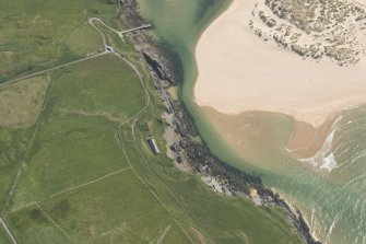 Oblique aerial view of dwelling house, ice house and boil house at Bettyhill Fishing Station, looking to the S.