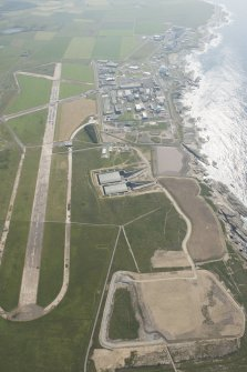Oblique aerial view of Dounreay, Nuclear Research Facility and airfield, looking to the SW.