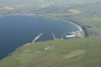 Oblique aerial view of Scrabster and harbour, looking to the S.