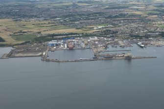 Oblique aerial view of the dockyard at Rosyth, looking NNE.