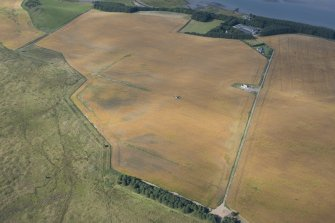 Oblique aerial view of the cropmarks of the rig with Waterside farmstead beyond, looking WSW.