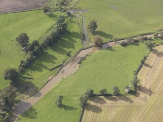 General oblique aerial view of Herdmanston dovecot with adjacent West Gate and Chapel, looking to the NW.