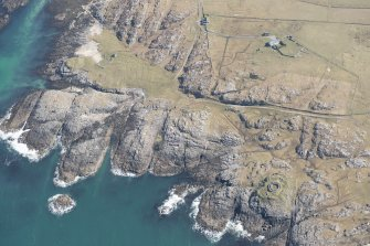 Oblique aerial view of Vaul, Dun Beag, Tiree, looking SE.