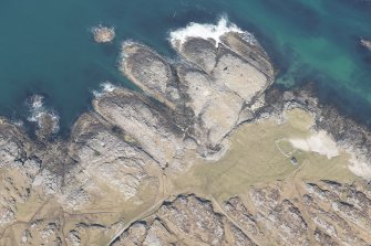 Oblique aerial view of Vaul, Dun Beag, Tiree, looking NNE.