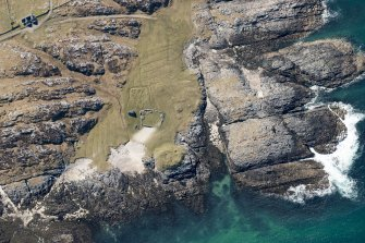 Oblique aerial view of Vaul, Dun Beag, Tiree, looking W.