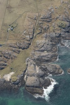 Oblique aerial view of Vaul, Dun Beag, Tiree, looking WSW.
