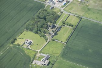 Oblique aerial view of Pitsligo Castle, looking SW.