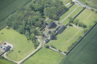 Oblique aerial view of Pitsligo Castle, looking SSW.