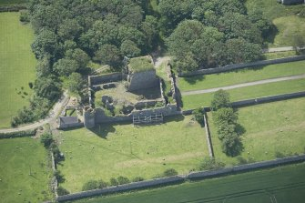 Oblique aerial view of Pitsligo Castle, looking S.