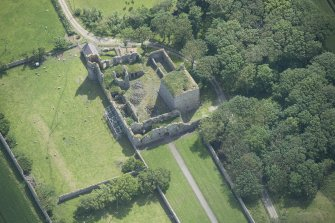 Oblique aerial view of Pitsligo Castle, looking ESE.