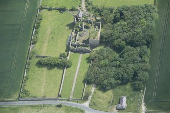 Oblique aerial view of Pitsligo Castle, looking ENE.