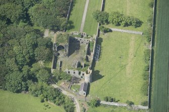 Oblique aerial view of Pitsligo Castle, looking WSW.