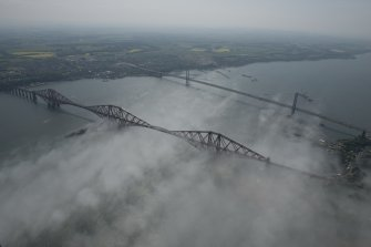 General oblique aerial view of the Forth Bridge and the road bridge, looking SW.