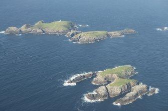 Oblique aerial view of Soraigh with Eilean Mor and Eilean Tighe, Flannan Isles, beyond, looking to the NNE.