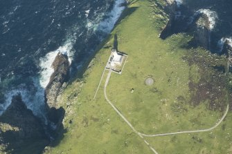 Oblique aerial view of the lighthouse and St Flannan's chapel on Eilean Mor, Flannan Isles, looking to the ENE.