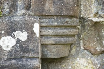 Detail of west corbel (possibly replaced) to middle order of door archway.