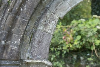 Detail of decorative carving to orders of abbey doorway.