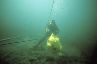 On the sea-bed a diver attaches a lifting bag to the 5m scaffold grid for its final positioning. (Colin Martin)