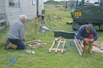 Dr Colin Martin (left) and Graham Scott preparing pallets for lifting large waterlogged items. (Edward Martin)