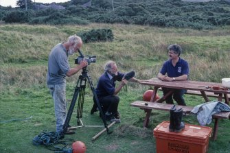 Video footage has been taken throughout the project to enhance the archaeological record and for publicity and educational purposes. Here Dr Ian MacLeod (right) does a piece to camera with Ray Sutcliffe (formerly of BBC Chronicle) recording the sound and Dr Colin Martin operating the camera. (Edward Martin)