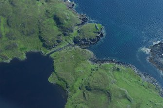 Aerial photograph of the canal and headland fort from the NW. The cleared channel towards the mouth of the canal is evident. (Colin Martin)