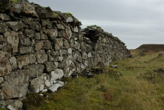The Slochd Dubh – Black Dyke – a stone wall running from one side of the Rubh' an Dùnain peninsula to the other, evidently defining a territorial boundary. Though the present wall is relatively modern its line shows modifications and traces of earlier structures, and the line may be of some antiquity. (Colin Martin)