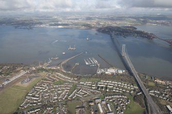 General oblique aerial view of the construction of the new Queensferry, the Forth Road Bridge and Port Edgar, looking NNE.
