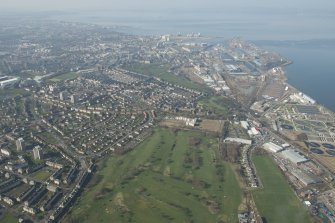 Oblique aerial view of Seafield Sewage Works and Leith Docks, looking to the NNW.