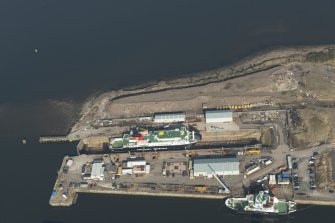 Oblique aerial view of James Watt docks, looking to the NNE.